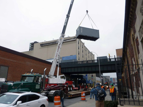 Trailer container being lifted off their 20th Street location and moved to ground level at Gansevoort & Washington Streets.