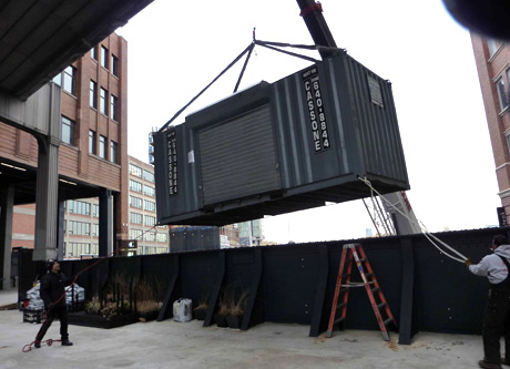 Container being set down into its new location just west of the Gansevoort Entrance.